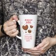 Girl is holding white Latte Mug in hands. Womans gift. Mockup for designs